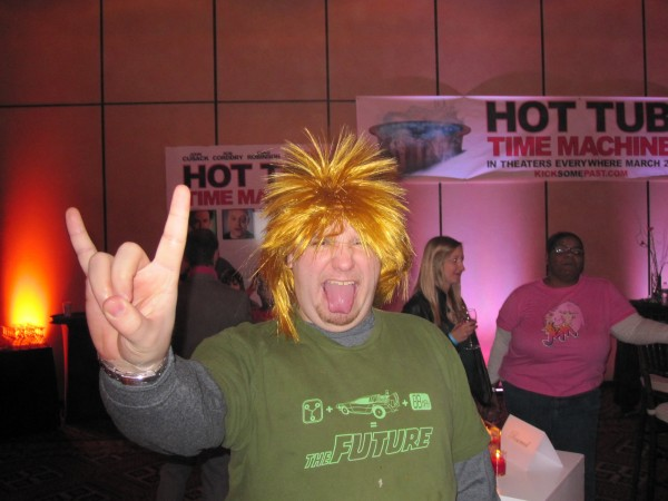 I rock it 80s-style, i.e. 80s-hair wig and devil horns