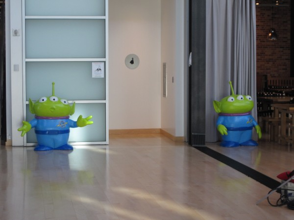 """The """"Toy Story"""" aliens welcome you to the restroom."""
