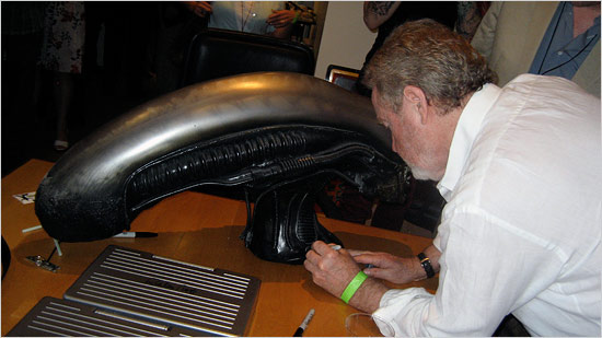 ridley-scott-signing-alien-xenomorph-head-image