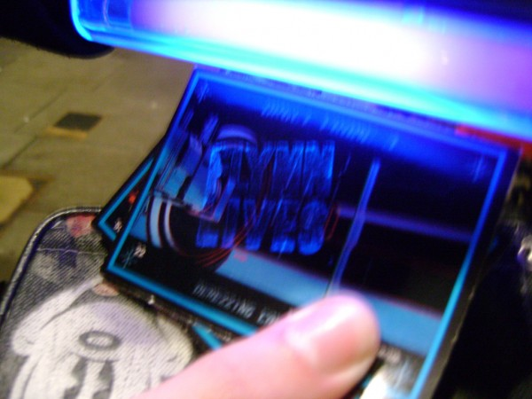 tron_legacy_viral_trading_card_blacklight_01